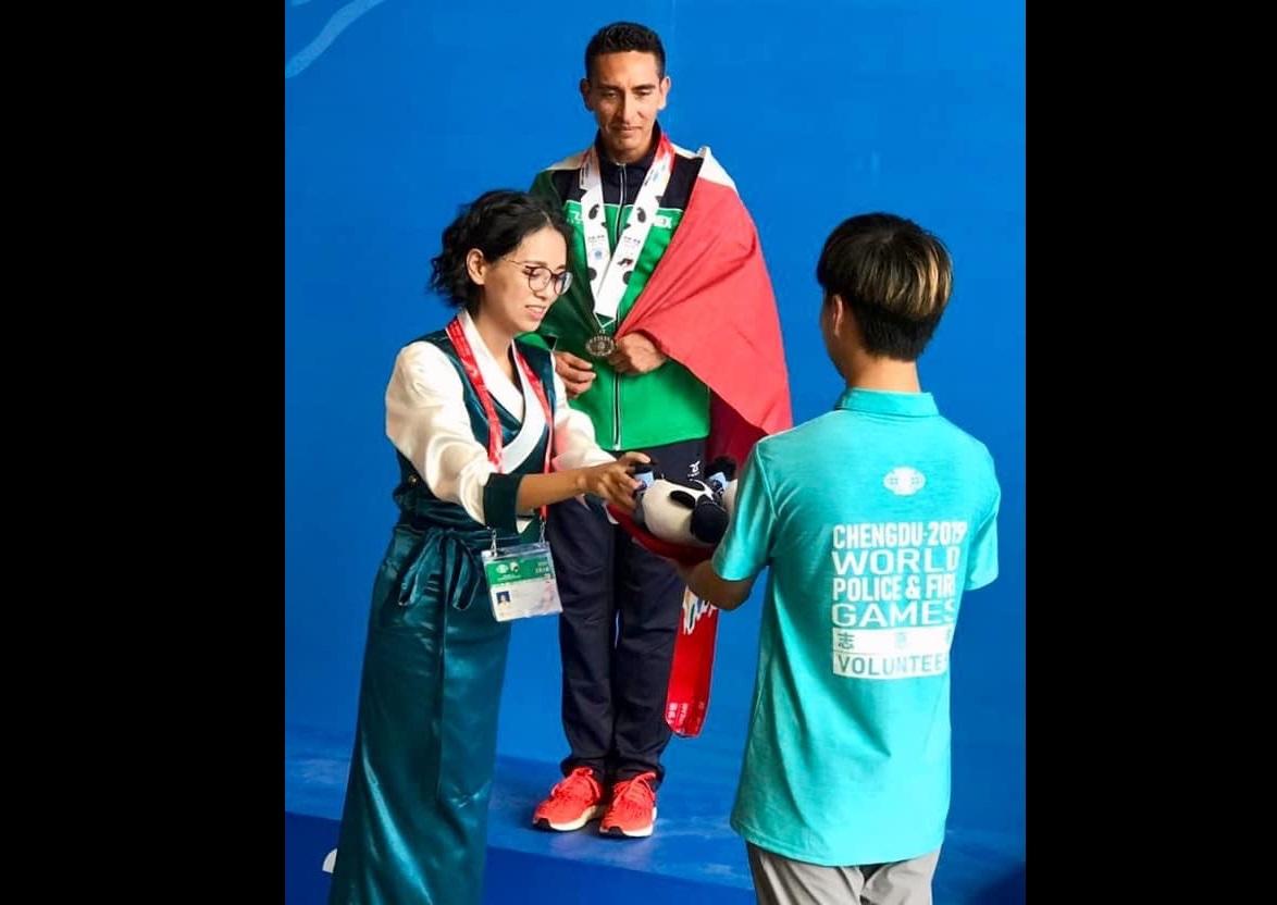 Policía atlixquense gana medalla de plata en China