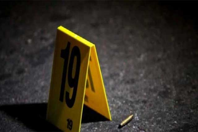 Frente a su hijo, los asesinan a disparos en Huauquechula
