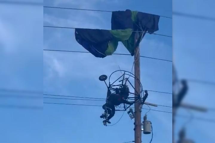 VIDEO Paracaidista termina aterrizaje en cables de luz