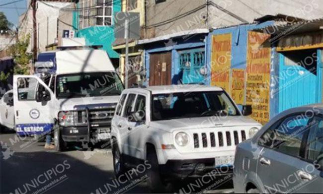 Fiscalía catea negocio de computadoras en barrio de Santiago en Puebla