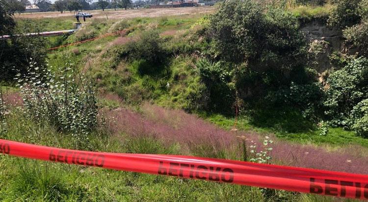 Arrojan cadáver de mujer al fondo de una barranca en Tochtepec