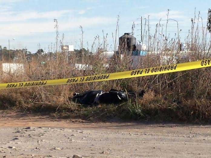 Dejan cadáver embolsado en libramiento a San Juan Tuxco, Texmelucan