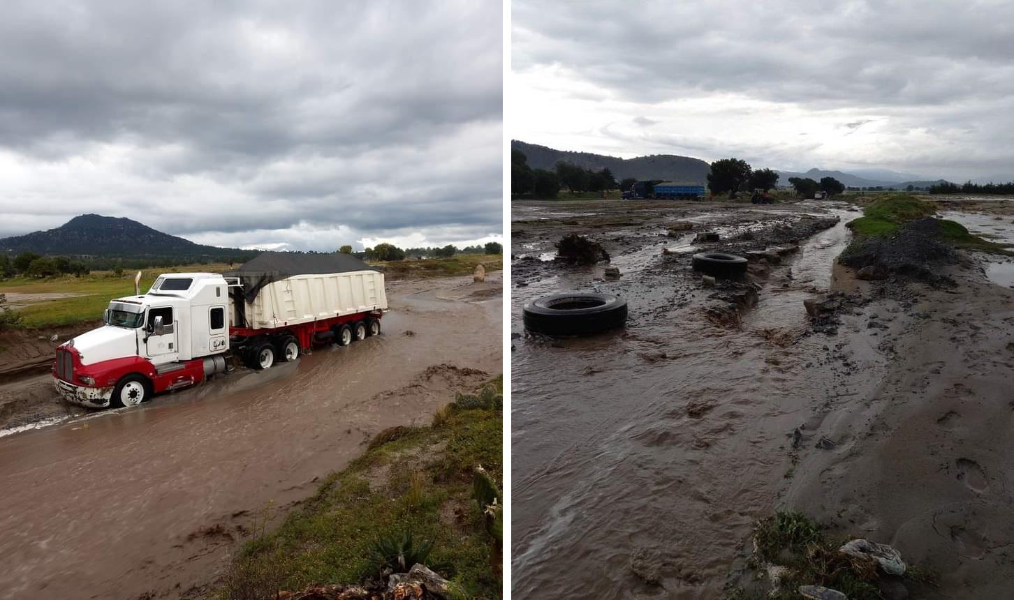 Lluvia inunda caminos y deja camiones varados en Oriental