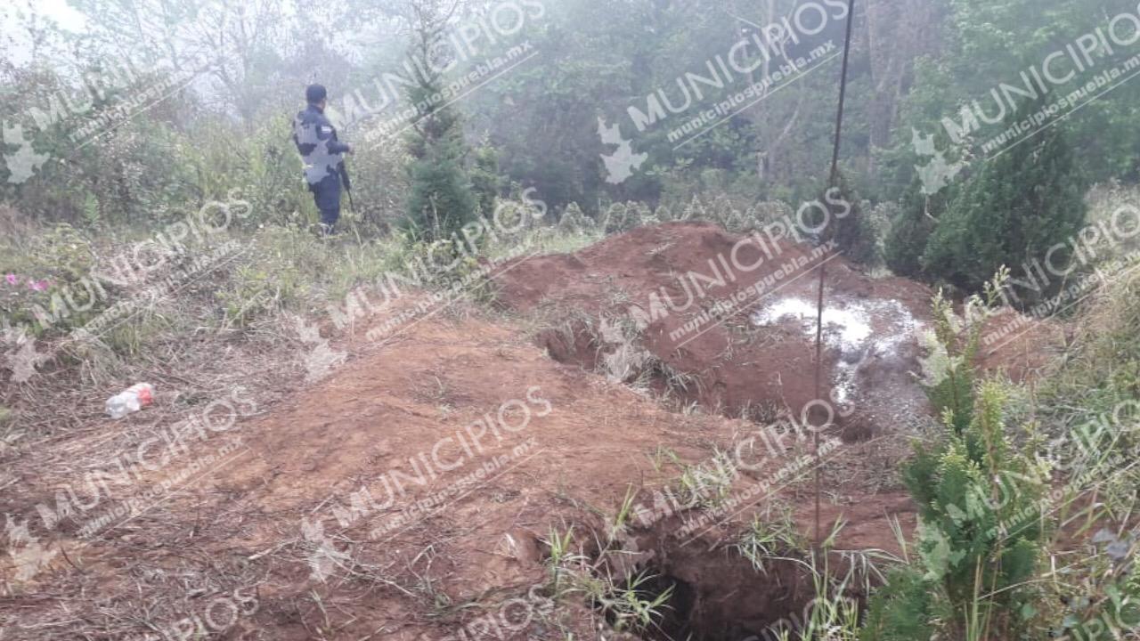 En fosa clandestina de Tlaola localizan el cadáver de un hombre