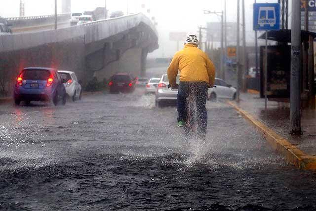 Alertan por lluvias muy fuertes en 10 municipios de Puebla