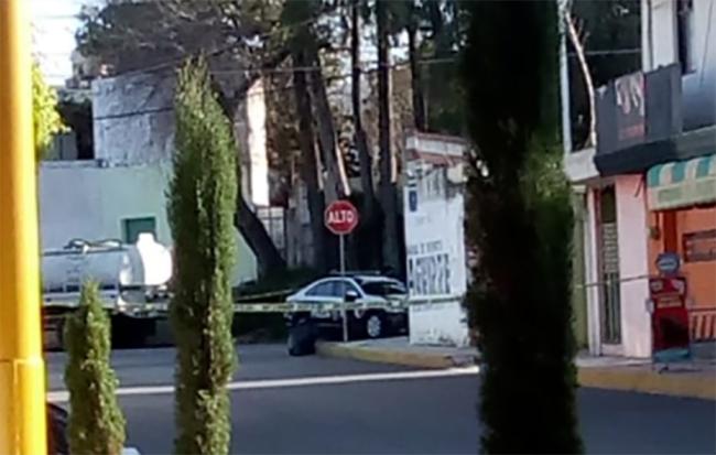 Hallan cadáver maniatado de joven en calles de La María en Puebla