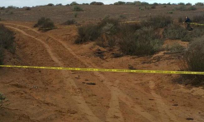 Campesinos hallan cadáver semienterrado en Tulcingo