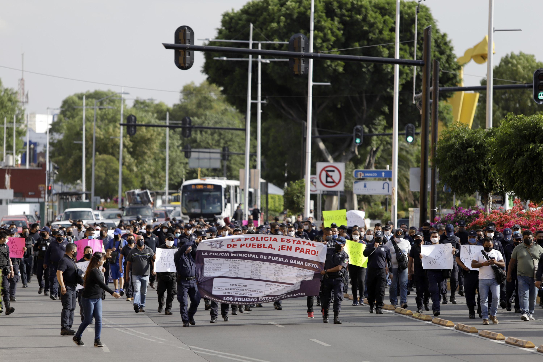 Policías seguirán en paro, Estado ofrecía aumento de 100 pesos