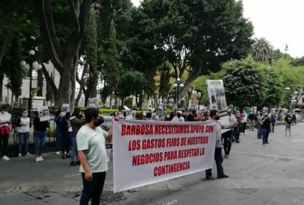 VIDEO Locatarios y comerciantes se suman a la campaña Abrir o Morir en Puebla