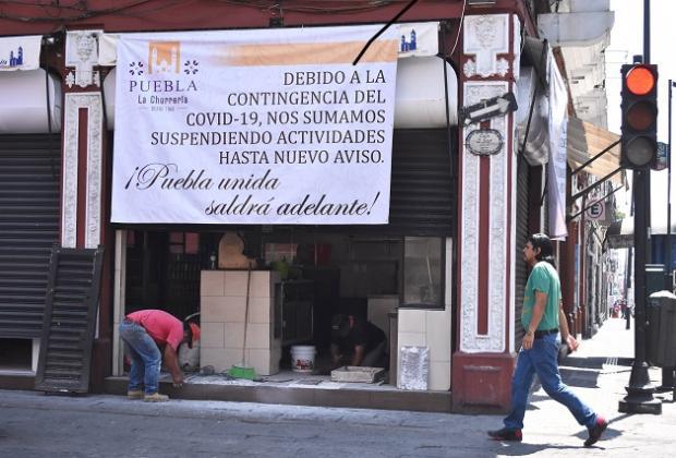 Con aforo del 30%, industria, comercio y servicios reiniciarán actividades en Puebla