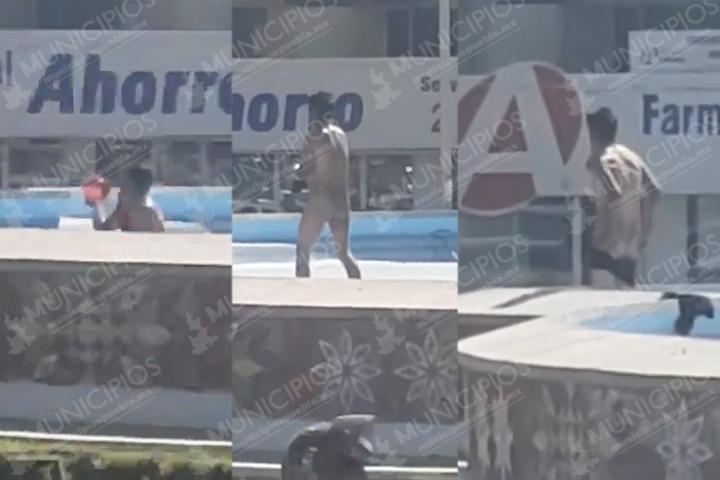 VIDEO Captan a sujeto bañándose en la fuente de la China Poblana