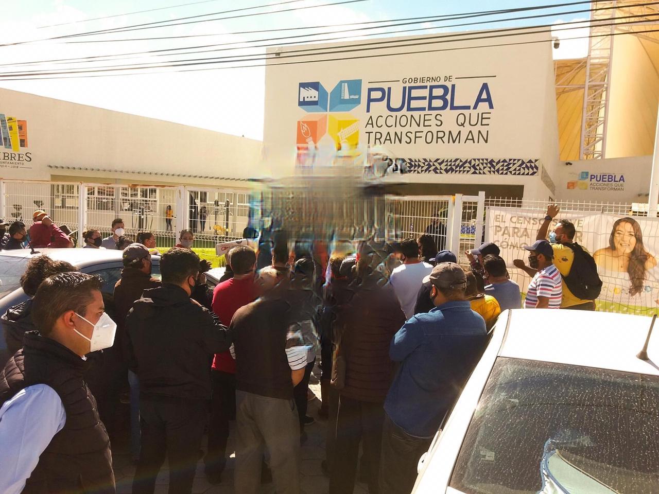 Manifestación de comerciantes en Libres debido a la pandemia